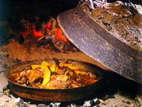 Omis (Dalmatia) Gastronomy - meat under the baking lid